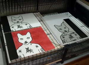A lino block and prints on the drying rack