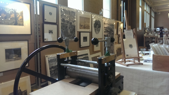 Work by David Frazer on view plus his portable printing press
