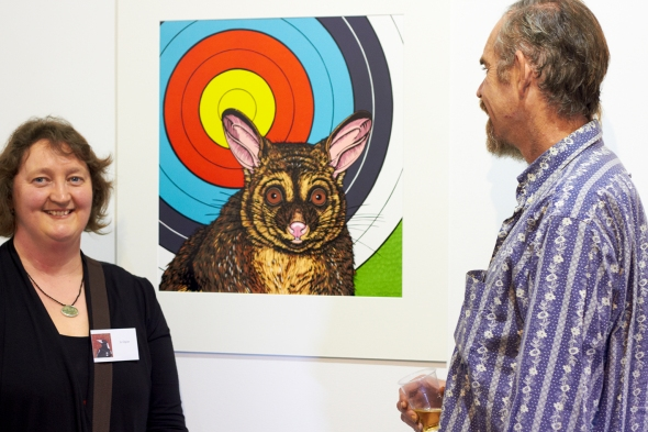 Jo Ogier talking about her woodcut print 'Target' with a fan of her work